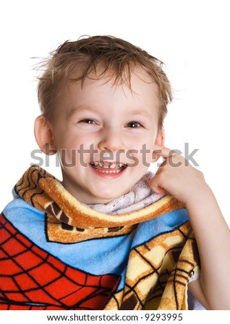 Cheerful kid in bath towel