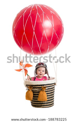 cheerful kid on hot air balloon - stock photo