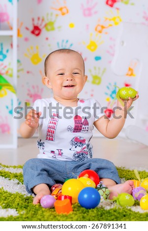 cheerful kid playing at home on the carpet