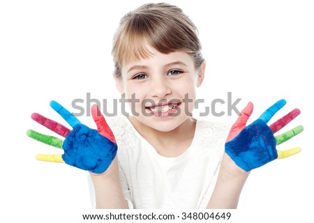 Cheerful kid showing her painted palms - stock photo