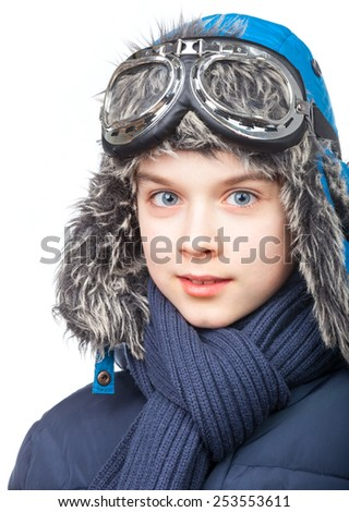Cheerful kid wearing winter clothes on white background - stock photo