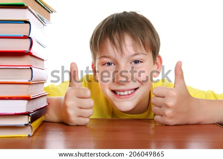 Cheerful Kid with a Books and OK Gesture on the White Background - stock photo