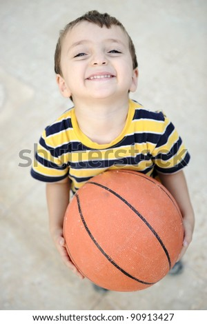 Cheerful kid with basket ball - stock photo