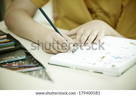 Cheerful kids at school room having education activity - stock photo