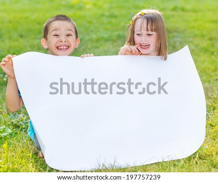 Cheerful kids holding blank paper - stock photo