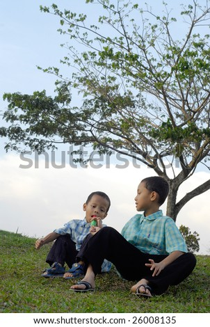 Cheerful kids sit while having ice cream