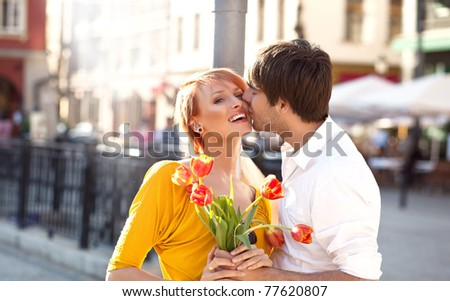Cheerful kissing couple - stock photo