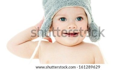 cheerful laughing baby in the hat. isolated.