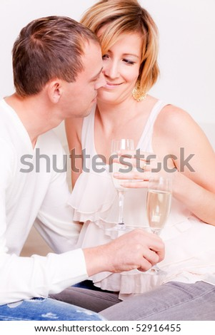 Cheerful laughing smiling drinking couple