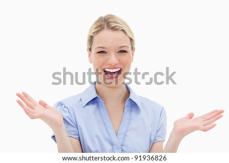 Cheerful laughing woman against a white background