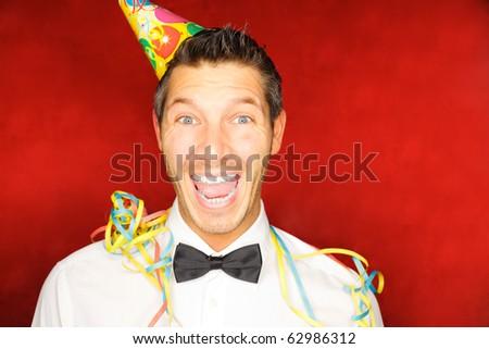 Cheerful lifestyle party celebrating boy enjoying successful party - stock photo