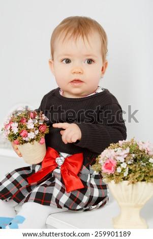 Cheerful little baby in the interior white studio - stock photo