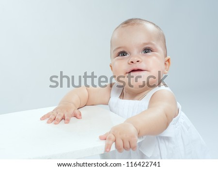 Cheerful little baby seven months - stock photo