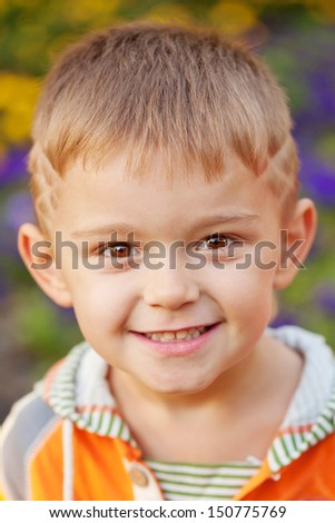 Cheerful little boy. Close-up portrait. - stock photo