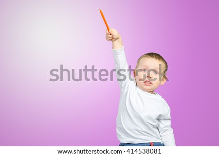 Cheerful little boy pointing up  - stock photo