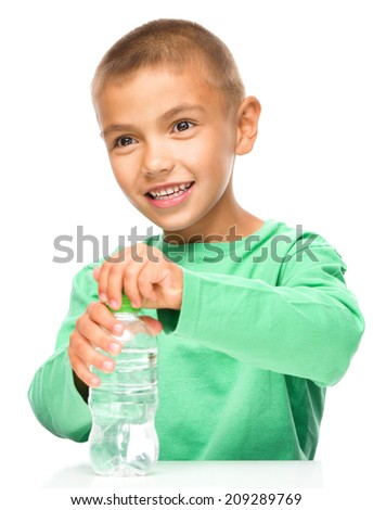 Cheerful little boy with plastic bottle of water, isolated over white - stock photo