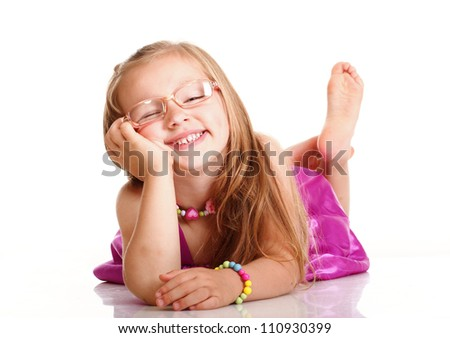 cheerful little girl glasses funny is lying isolated on the white background - stock photo