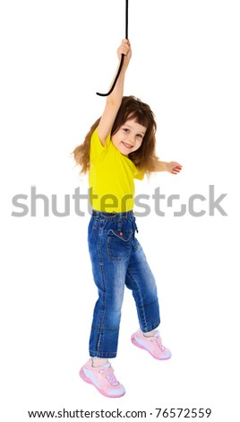 Cheerful little girl hanging on a rope isolated on white background - stock photo