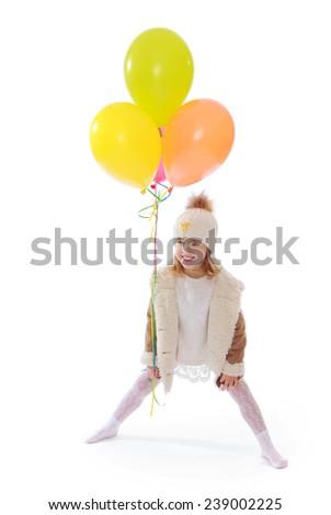 Cheerful little girl holding balloons. Studio photo, isolated on white background. - stock photo