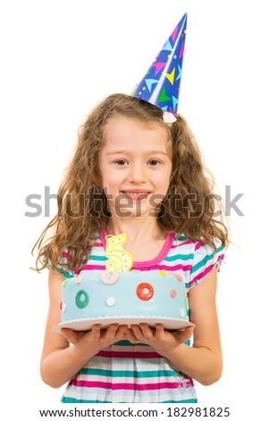 Cheerful little girl holding birthday cake isolated on white background - stock photo