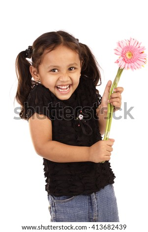 Cheerful little girl holding bunch of flowers - stock photo
