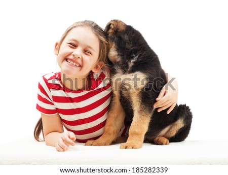 cheerful little girl hugging a puppy - stock photo