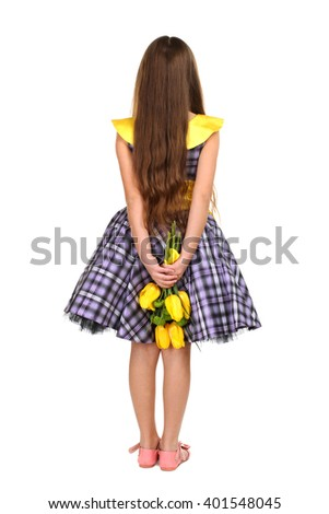 cheerful little girl in a beautiful dress with a bouquet of flowers turned her back on a white isolated background - stock photo