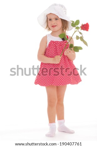 cheerful little girl in a pink dress.Isolated on white. - stock photo