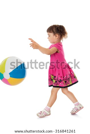 Cheerful little girl in a short pink dress playing with a bouncy ball. The girl is vacationing with his parents in the seaside resort-Isolated on white background - stock photo
