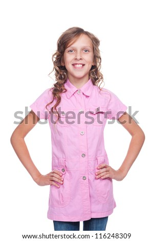 cheerful little girl in pink shirt posing against white background - stock photo