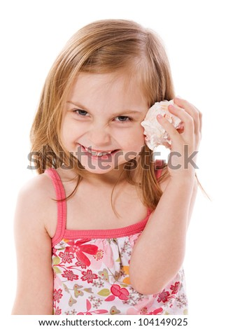 cheerful Little Girl listening shell isolated on white - stock photo