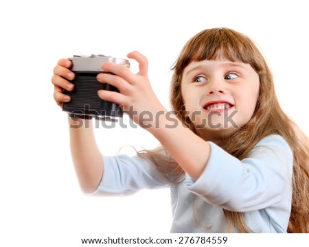 Cheerful Little Girl make a Selfie with Retro Photo Camera on the White Background