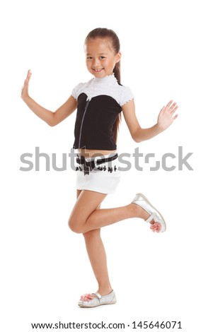 Cheerful little girl posing in fashionable clothes