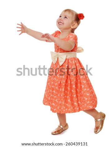 cheerful little girl runs arms spread wide - isolated on white. - stock photo
