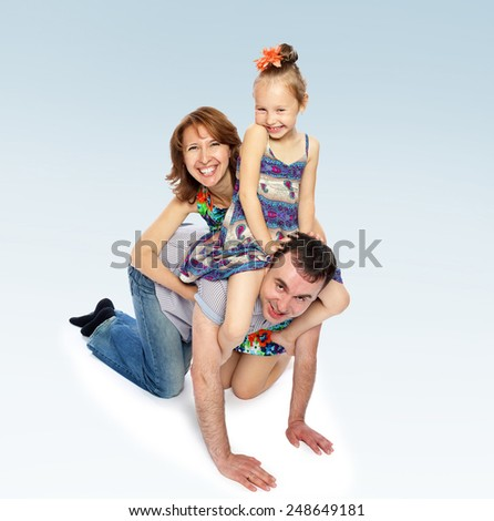 Cheerful little girl sit on the neck of the pope - stock photo