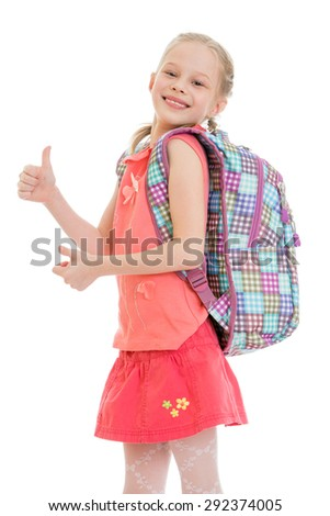 Cheerful little girl with a backpack, a hitchhiker , raising his thumb - isolated on white background - stock photo