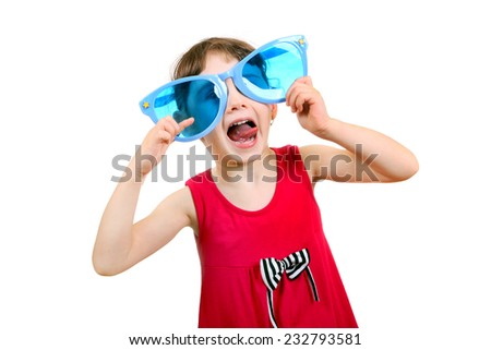 Cheerful Little Girl with Big Blue Glasses Isolated on the White Background - stock photo