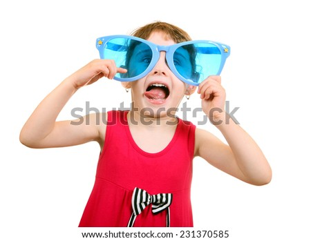 Cheerful Little Girl with Big Blus Glasses Isolated on the White Background - stock photo
