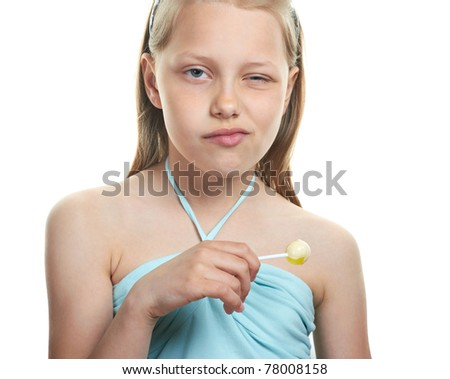 Cheerful little girl with lollipop on white - stock photo