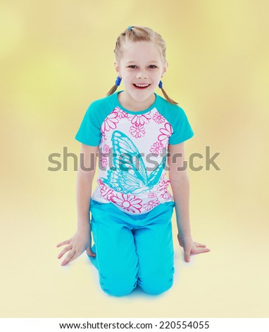 Cheerful little girl with pigtails vsportivnom suit.The concept of development of the child, the child's upbringing. - stock photo