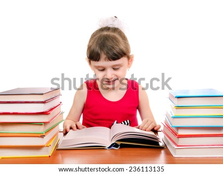 Cheerful Little Girl with the Books at the Desk on the White Background - stock photo