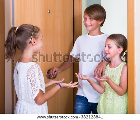 Cheerful little guests coming with friendly visit indoors in interior - stock photo