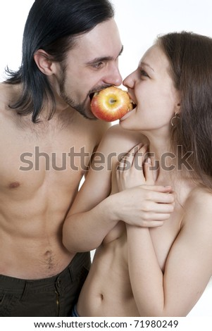 cheerful male and female eating apple - stock photo