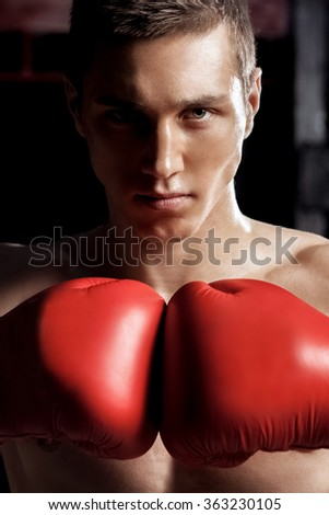 Cheerful male athlete is ready to fight - stock photo