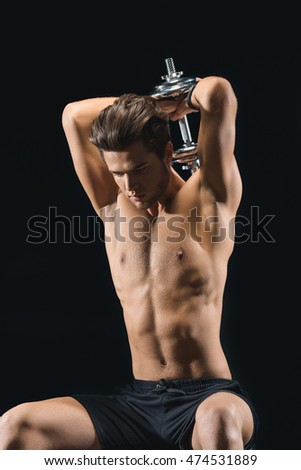 Cheerful male athlete lifting weight