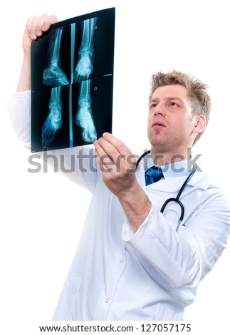 cheerful male doctor examining feet x-ray - stock photo