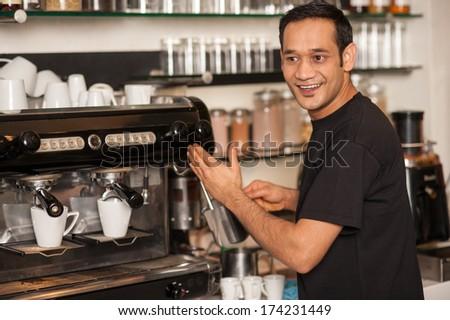 Cheerful male staff preparing the order - stock photo