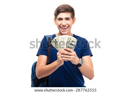 Cheerful male student holding money isolated on a white background. Looking at camera - stock photo