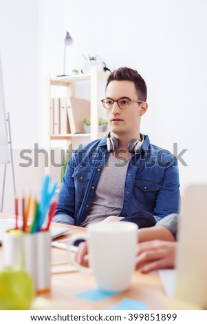 Cheerful male worker is explaining plan of project - stock photo