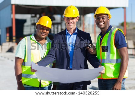 cheerful man architect team on construction site - stock photo